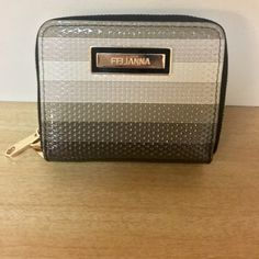 """Felianna Wallet Black, grey & white double zipper striped wallet...like new condition...Gold hardware...                 1 compartment has a zipper pocket, 3 card holders & 2 open pockets...The other side has 2 separate inside compartments...                                             H 4""""  W 5.5""""...Will also trade... Felianna Bags Wallets"""