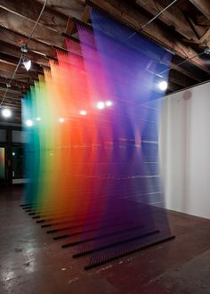 Gabriel Dawe's work has evolved into creating large-scale installations with multi-color threads, creating environments that deal with notions of social constructions.