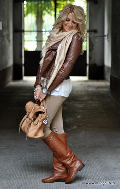 Brown Leather Blazer, Tan Scarf, White Tank Top, Tan Skinny Jeans, Brown Leather Boots, Tand Satchel Handbag, Wristwatch and Silver Bangle.
