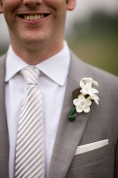 Grey & white groom (with a different boutonniere)