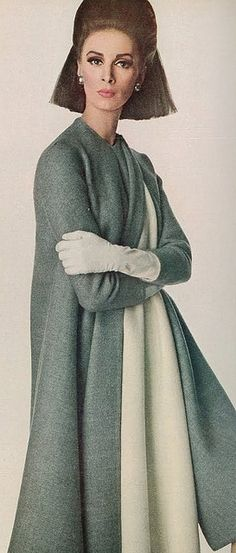 Silver grey coat over an ivory dress by Stavropoulos,Vogue 1966