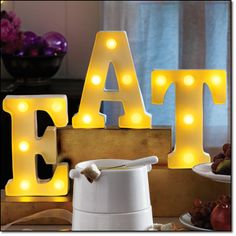 """LIGHT-UP MARQUEE Includes letters: """"E, A, T"""" that can be separated for multiple word options, iron, wipe clean, 5"""" x 8"""" x 2"""". Magalog: $29.99"""