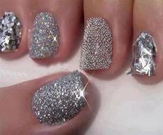 Chunky silver glitter nail polish manicure