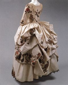 Rear view of Robe a la Polonaise, 1780, cream linen, gold embroidery, metal. (c) metropolitan museum of art