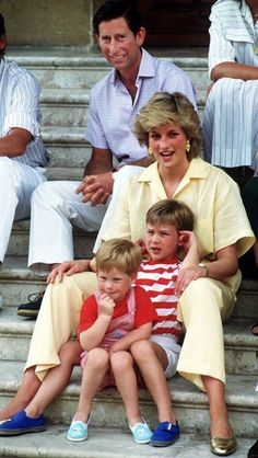 The Prince and Princess of Wales are snapped with Prince William and Harry while on holiday at the Spanish royal residence, Marivent Palace, in August 1987.