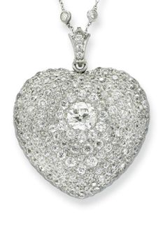 A BELLE ÉPOQUE DIAMOND HEART PENDANT. Designed as a heart-shaped pendant centering upon an old European-cut diamond, within an old European-cut diamond surround, mounted in platinum and gold, circa 1910; accompanied by a white gold fine link.  neckchain, spaced by collet-set diamonds, 15 ins. #BelleEpoque #pendant