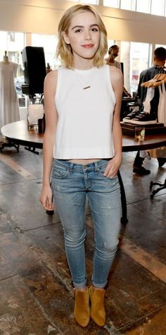 Kiernan Shipka was casual-chic at the Rag & Bone Sole Bicycle event in a breezy sleeveless white top, slightly distressed cuffed skinnies, layered delicate strands, and suede booties.