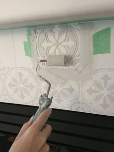 Stenciled Tile DIY Fireplace Makeover – Life Is Better At Home - Fireplace Decor Paint Fireplace Tile, Tile Around Fireplace, Fireplace Update, Brick Fireplace Makeover, Fireplace Hearth, Home Fireplace, Fireplace Remodel, Fireplace Refacing, Stone Fireplaces