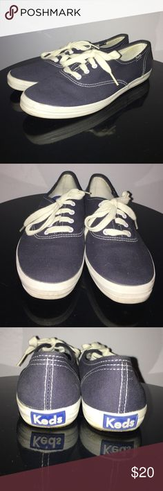 Keds Navy Blue Champion Originals Lace Up Sneakers Up for grabs is this pair of shoes from Keds. They are a size 7 and are a lace up style. These shoes are the Champion Originals style in navy blue. They are lace ups with white detailing. These sneakers have been gently worn and are in excellent condition. Keds Shoes Sneakers