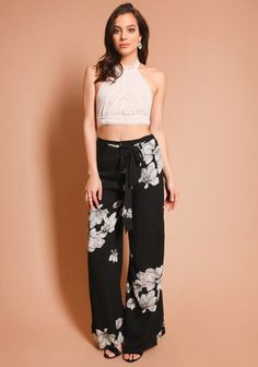 65602d7e21 Black floral wide pants with tie fastening and hidden side closure.