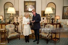 Camilla, Duchess of Cornwall meets radio presenter Chris Evans following the launch of BBC Radios 2's '500 Words', a children's story-writing competition which is supported by the duchess, in the Morning Room at Clarence House on January 20, 2015, in London, United Kingdom.