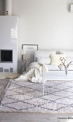 All white minimalist living room with lots of textures