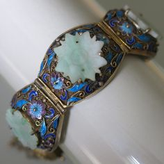 A vintage Chinese silver filigree and Jade bracelet.