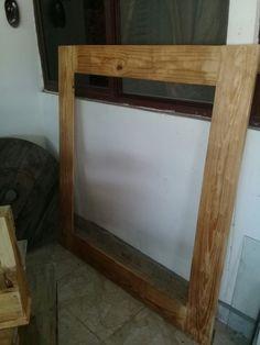 Marco de espejo de madera reciclada