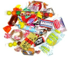 Penny candy...there was a mom & pop store on every corner in our neighborhood.  The candy was in a case behind glass, and as you told the clerk what you wanted, he would put it in a small brown paper bag.  Fireballs, dots, Bazooka bubblegum and squirrels were a few of my favorites!  Remember how hard it was trying to decide what to buy with your nickel?