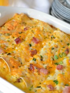 "Overnight Breakfast Enchiladas recipe. One pinner said ""I made this to use up leftover ham and to feed company from out of town and everyone raved about them! This is definitely going into my favorites file!"""