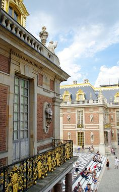 Chateau de Versailles Interpret; french doors, placards with freezes or accents, front porch rug with pattern used on courtyard