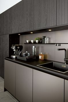 Make good use of the splashback area with this recessed slimline rail system in matt black from Pronorm. You can add shelves, a paper towel holder, knife block, bottle holder and clock can be hung. Nice. | #darkitchen #blackkitchen #homedesign #interiorinspo #renovation #homedecorideas #dreamhome #homeremodel #interiordesign #kitcheninspo #dreamkitchen #kitchendecor #storageideas #stoarge #kitchenstorage #kbbmag