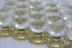 Glass door knobs chequerboard in clear glass with brass backs. For more visit Priors: http://www.priorsrec.co.uk/door-furniture/door-knobs/glass-door-knobs/c-p-0-0-3-22-47