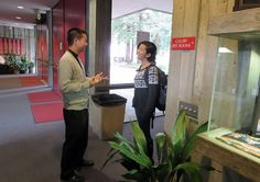 Father Dat Tran, CSP, stops to speak with a Berkeley student in the lobby of Newman Hall-Holy Spirit Parish at the University of California at Berkeley.