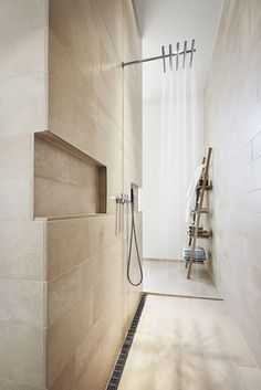 This would be like showering under a waterfall each day. beautiful detail: shower niches