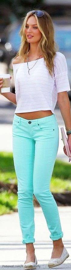 Mint green skinny jeans and off the shoulder white top