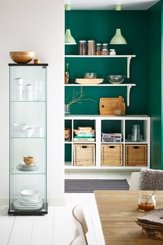 This peekaboo colored corner draws attention to the dark mint green, establishing a bold accent in the room.