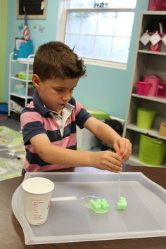 Working with Frozen Letters to make them fizz! Make letters out of  baking soda, water, and jello, freeze, and then have students squirt vinegar on letters! This activity strengthened fine motor control, sensory awareness, letter identification, letter sounds, counting, and problem solving skills all while having a blast!