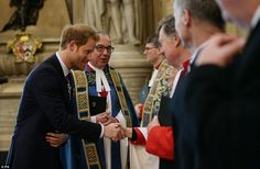 He was then introduced to Westminster Abbey dignitaries by the Very Rev Hall, centre, befo...