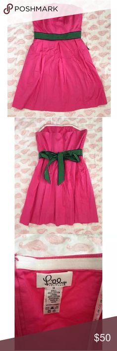 Lilly Pulitzer Hot Pink Dress with ribbon belt Size 12. Excellent used condition. Navy and lime green grosgrain ribbon belt is attached to dress. White label collection. Lilly Pulitzer Dresses Strapless