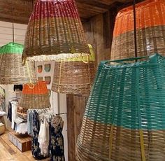 Pendant lights using smaller baskets than these, painted colors or a subtle brown.