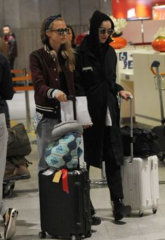 Cara Delevingne and Annie Clark airport style.
