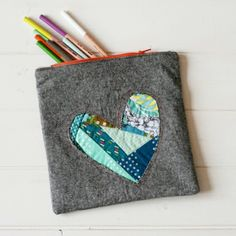 Try this Patchwork Heart Zipper Pouch Tutorial to make useful homemade gifts for Valentine's Day.