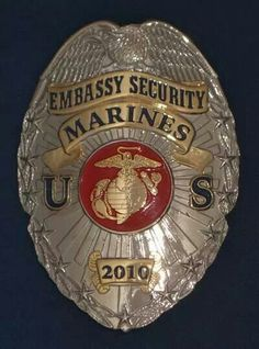 A badge of a member of the U.S. Marine Corps Embassy Security Group. 1856 w 11th place