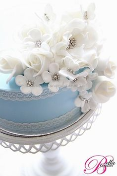 Blue and White cake with Lace and White Flowers