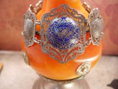 """Vintage sterling bracelet enamel European blue silver filigree celestial design. This antique hallmarked sterling European silver and enamel bracelet is so beautiful with ancient celestial designs on it. The bracelet measures 7"""" long and 1 1/2"""" at its widest. Intricate filigree with domes links makes this bracelet a piece of artistry that is gone forever. Ask about our ten percent off special before you buy, it could save you a lot of money. VintageSparkles offers Layaway on all our pieces…"""
