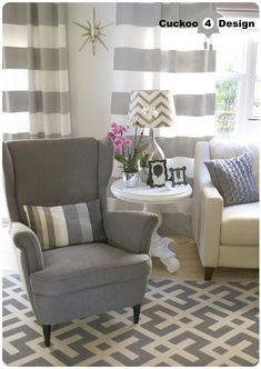 The chair // Ikea Strandmon chair, grey horizontal striped curtains, Overstock indoor/outdoor area rug