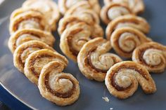 Swirls of a delicious cheese and ham mixture run through small circles of pastry. Your guests will never know how easy they are to make!