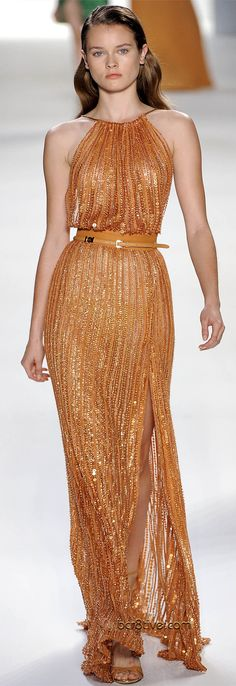 Copper long dress. Sheer fabric covered with vertical strips of different size sparkling beads and sequins. String gathered halter neckline. Waist cinched with a slightly obi-inspired matching belt. Designer: Elie Saab