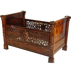 Antique Victorian baby crib executed in beutifully carved rosewood by Alexander Roux.