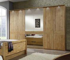 Skriňa IBIZA 421 596 už na prvý pohľad dýcha luxusom a štýlom. Skriňa je vyrobená z čiastočného dubového masívu. 2 dvere ľavé, pravé sú vyrobené z masívneho dubu a zrkadlové dvere sú z drevotriesky. Skriňa je vybavená 2 policami a jednou šatníkovou tyčou. #byvanie #domov #nabytok #skrine #klasickeskrine #modernynabytok #designfurniture #furniture #nabytokabyvanie #nabytokshop #nabytokainterier #byvaniesnov #byvajsnami #domovvashozivota #dizajn #interier #inspiracia #living #design Ibiza, Divider, Room, Furniture, Home Decor, Bedroom, Decoration Home, Room Decor, Rooms