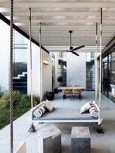 LOVE THIS!! Who needs outdoor furniture if you have hanging daybeds!! style-files.com
