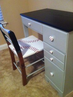 I used chalkboard paint on the top and painted to knobs to look like baseballs