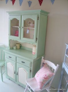 Love the painted hutch with contrasting panels and backboard! Restyled Vintage: Vintage Green Kitchen Dresser/Hutch
