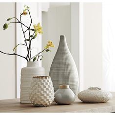 Shop Holden White Ribbed Vase. Mid-century angles get the run around in ribbed earthenware vase, finished with a creamy white reactive glaze that showers speckles all over.