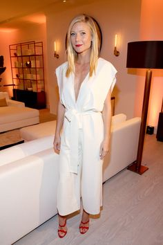 Pin for Later: The Real Reason Your Favorite Stars Look So Darn Good on the Red Carpet  Gwyneth is all about easy-breezy outfits and Elizabeth gets that, putting her in moveable jumpsuits like this white plunging option.