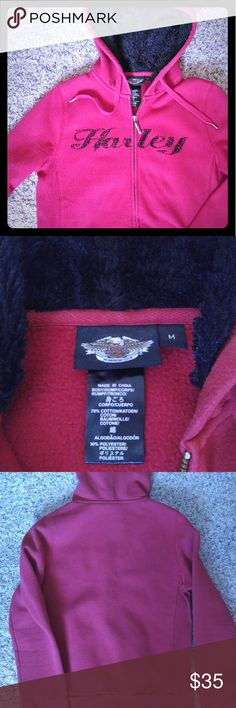 Harley Davidson sweatshirt Red Harley sweatshirts, inside hood is black and fuzzy. Sequence on front is black.has 2 pockets and is a zip up. Super comfy. Size medium, fits more like a small. Harley-Davidson Other