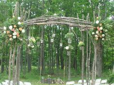 Mason Jars Wedding Arch. Hanging mason jars with candles and flowers is a great inexpensive idea for an outdoor wedding. http://hative.com/cool-wedding-arch-ideas/