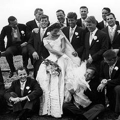 Kennedy wedding. So classic and lovely!  Her dress, the suits and carnation boutineers.  Love it.