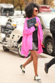 Julia Sarr-Jamois exited Chanel with that megawatt smile, Nike trainers, and a pop of pink on a sporty-girl anorak.